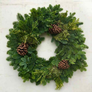 wreath with mixed evergreens and pine cones