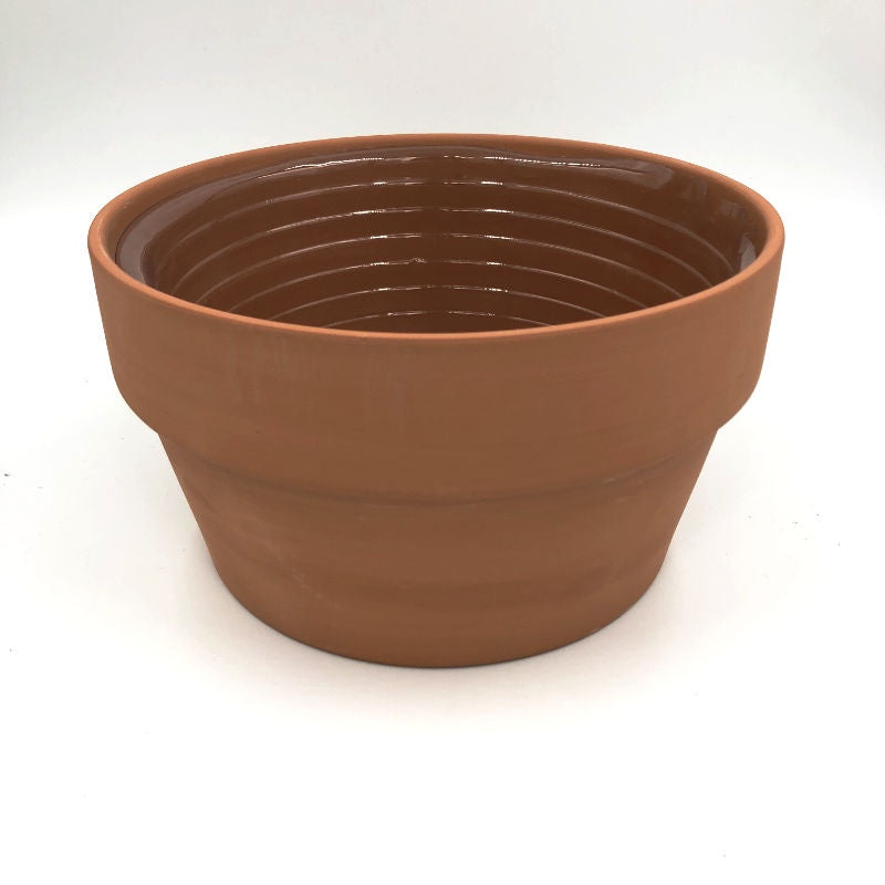 round clay pot with plastic liner