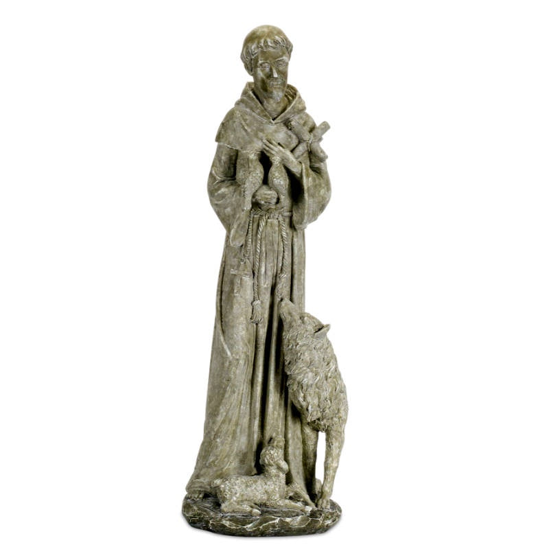 weathered grey status of st francis with animals at his feet and holding a cross and a bird