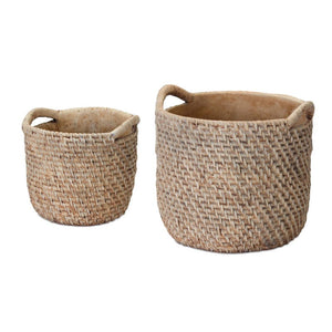 image of two cement pots made to look like woven baskets with handles.  One larger than the other