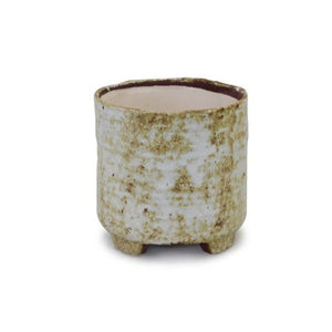 photo of medium round pot with rustic white and amber finish and small legs underneath