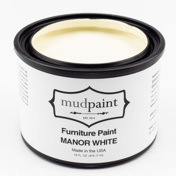paint chip in light creamy white, with the word mudpaint at the bottom right