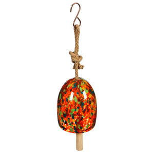orange with green and blue speckled glass bell hanging on a rope from a metal hook