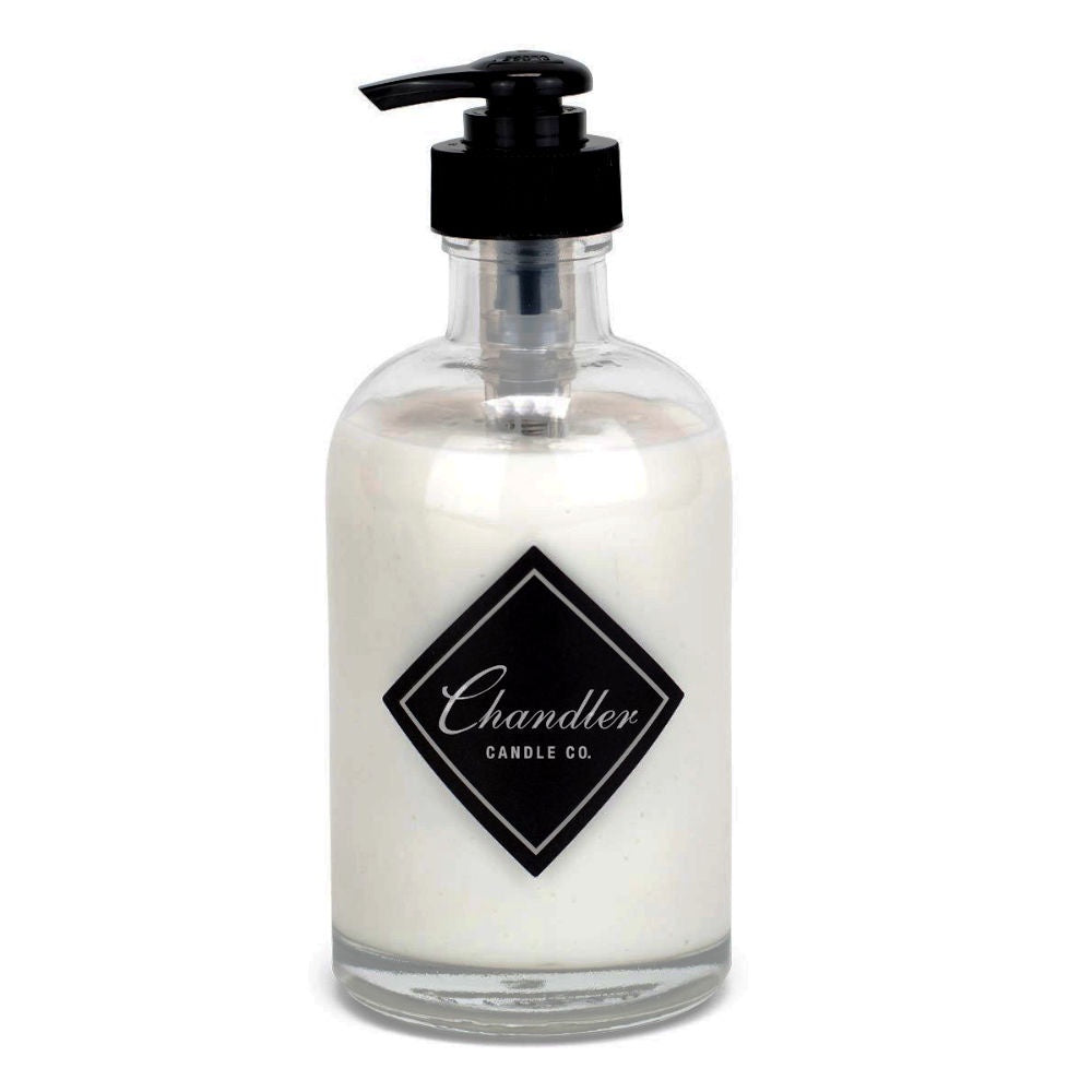 glass jar with black pump top, black Chandler logo, filled with white hand lotion