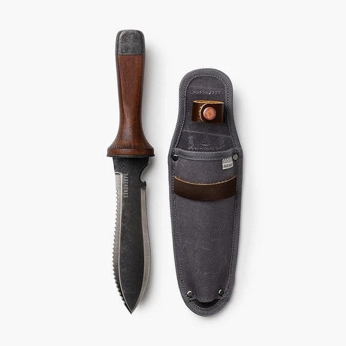 photo of hori hori knife with wide metal blade and wooden handle, next to a grey waxed canvase belt holster for the hori hori