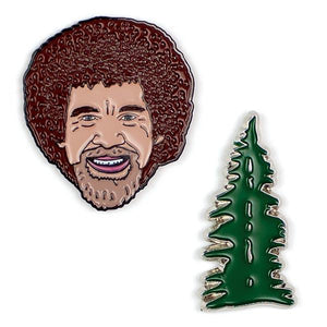 image of two pins.  one of Bob Ross's head and the other of an evergreen tree