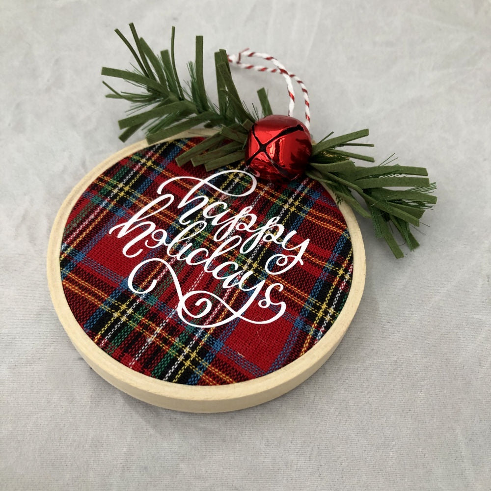 plaid fabric with happy holidays in white