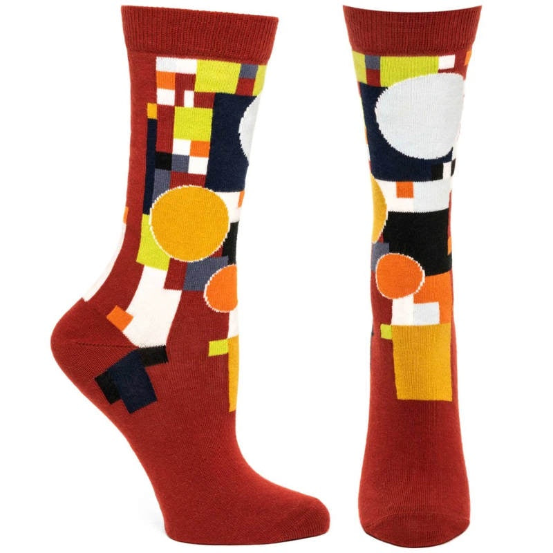 tall red socks with multi color geometric design