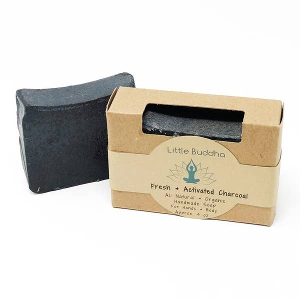 image of charcoal soap bar next to brown kraft box