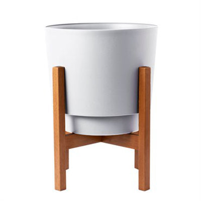 White modern style pot in wooden stand