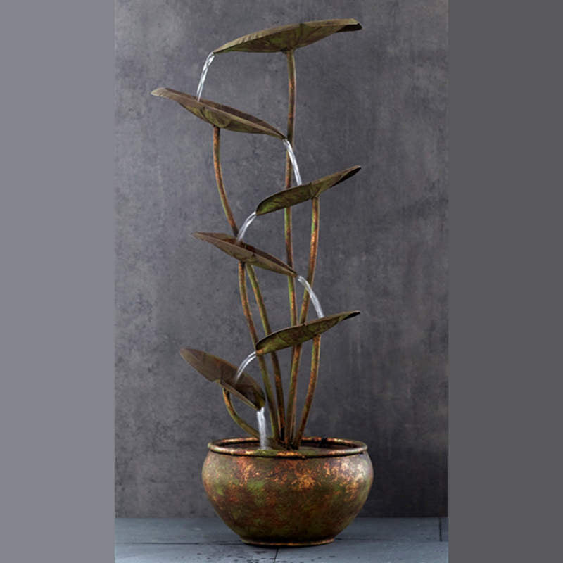 bronze toned metal fountain with 6 lotus shaped waterspouts above a metal base