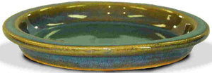 image of green glazed saucer