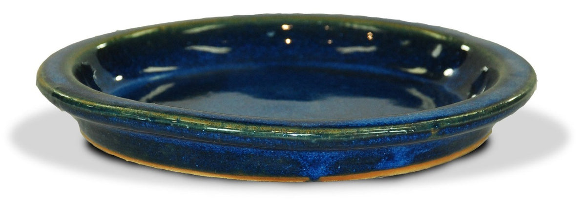 image of blue glazed saucer