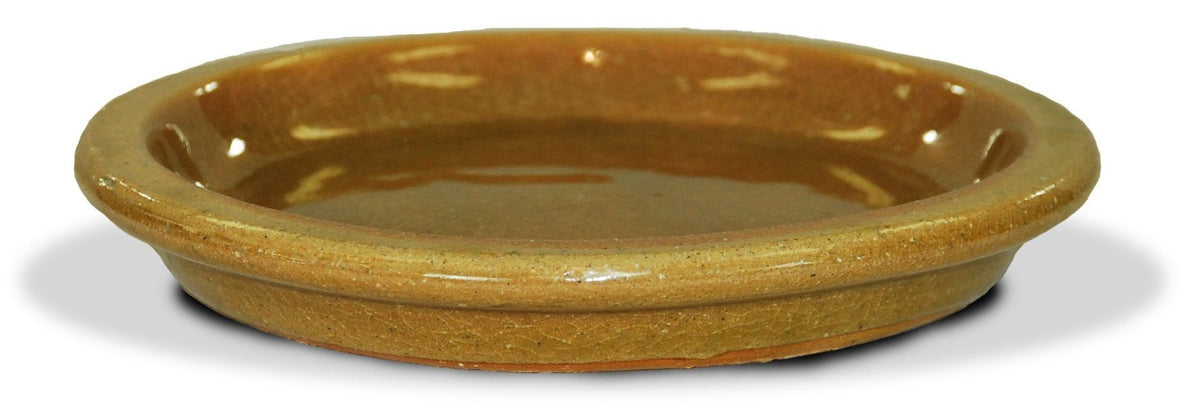 image of golden yellow glazed saucer