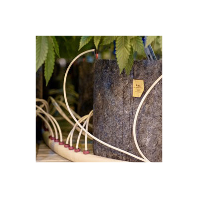 image of grey grow bag with hydroponic watering equipment
