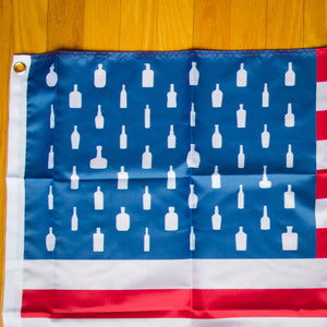 Each flag features 50 different bourbon bottle outlines.