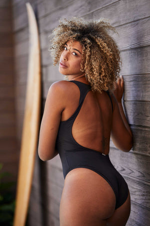 woman in black one piece swimsuit