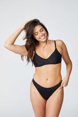 woman wearing a two piece black bikini