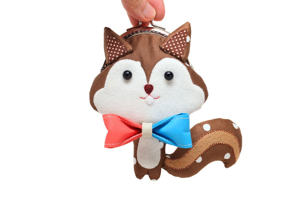 Hand-painted bow brooch and chestnut squirrel, limited edition gift package and artist collaboration project with 10/10 design studio
