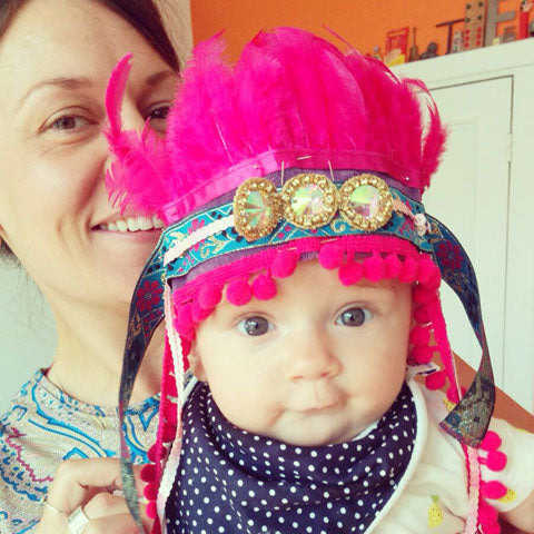 "Om Baby says ""festival headdresses coming soon"""