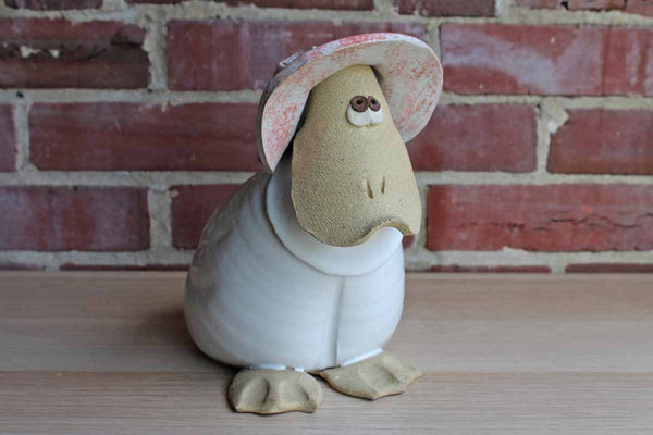 Primitive Stoneware Mother Goose Coin Bank