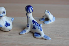 Blue and White Ceramic Figurines of a Frog, Seal, and Duck
