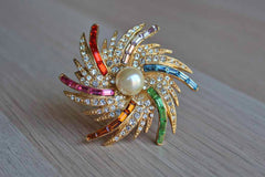 Pell Brothers Jewelry Co. (New York, USA) Colorful Rhinestone and Faux Pearl Swirling Starburst Brooch