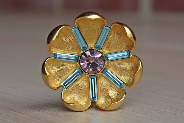 Trifari (USA) Gold Flower Brooch with Blue and Pink Rhinestone Accents