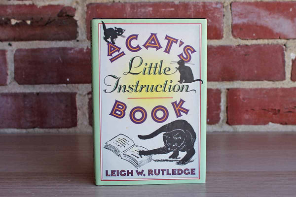 A Cat's Little Instruction Book by Leigh W. Rutledge