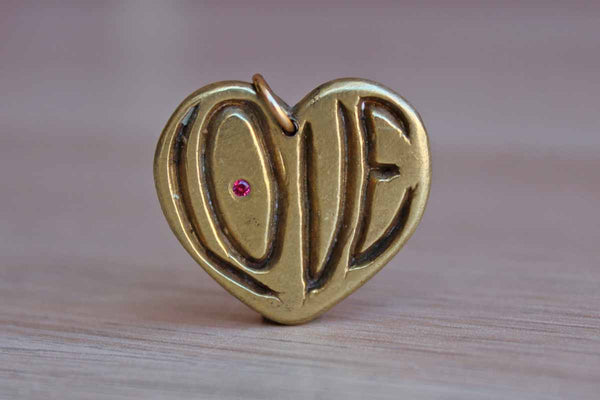 "Brass ""Love"" Charm with Little Red Inset Rhinestone"