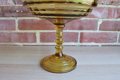Gold Glass Centerpiece with Cut Glass Bowl and Stacked Wafer Stem