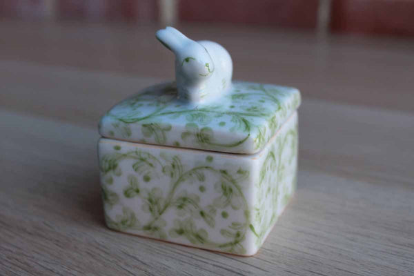 Andrea by Sadek (Made in Thailand) Little Porcelain Box Decorated with Green Flowers and Bunny Finial
