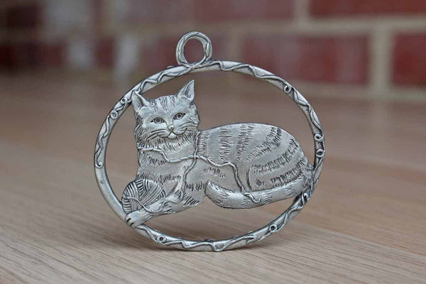 Pewter Ornament of a Lounging Domestic Long-Haired Cat with a Ball of Yarn