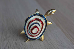 Gold Tone Turtle Brooch with Rhinestone Eyes and Red, White, and Blue Painted Shell