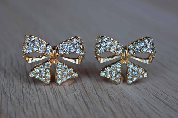 Gold Tone and Silver Rhinestone Bow Shaped Pierced Earrings