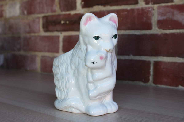 Glossy White Porcelain Planter of a Mother Cat Holding Kitten with Her Mouth