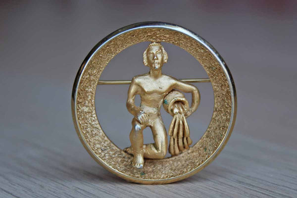 Trifari (USA) Gold Tone Aquarius the Water Bearer Zodiac Brooch (January 20-February 18)