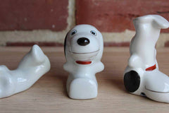 Porcelain Figurines of Snoopy in Various Poses, Set of 4