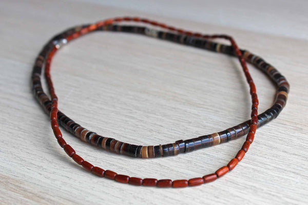Pair of Polished Wood and Brown Stone Beaded Necklaces