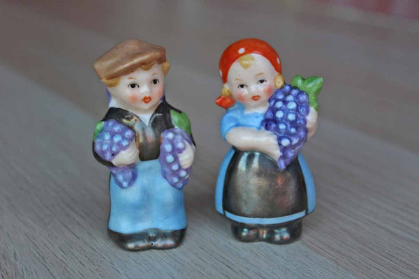 Small Porcelain Salt and Pepper Shakers Shaped Like Little Children Carrying Grape Clusters