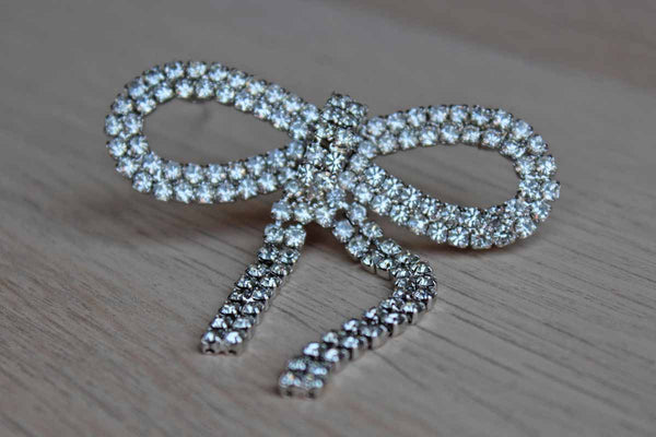 Silver Tone Rhinestone Ribbon-Shaped Brooch