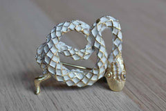 Gold Tone and White Painted Snake Brooch