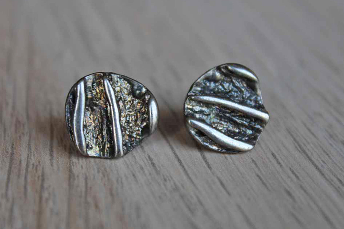 Silver Pierced Earrings with Textured Abstract Design