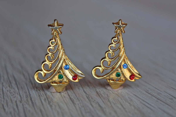 Gold Tone Pierced Earrings Shaped like Christmas Trees with Colorful Rhinestones