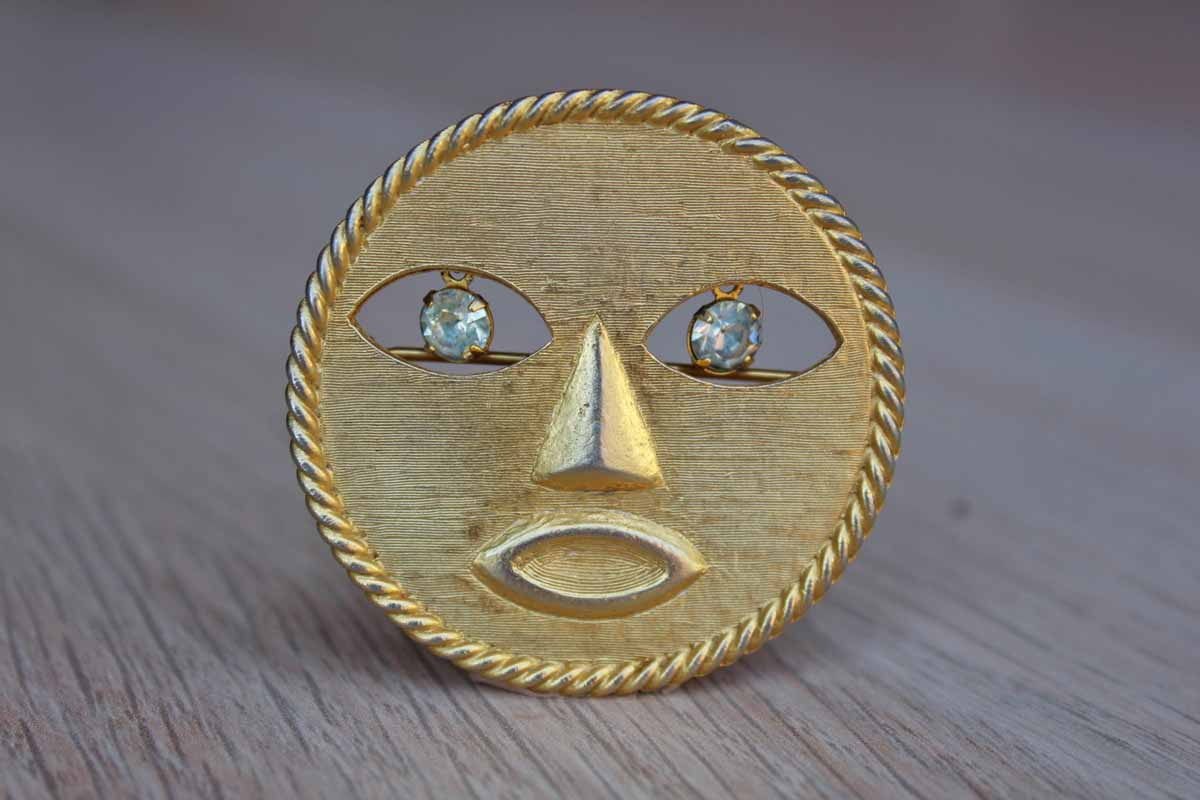 Jeanne (New York) Gold Tone Modern Sun Brooch with Dangling Silver Rhinestone Eyes