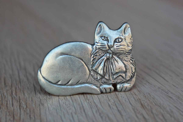 Seagull Pewter (Canada) Pewter Brooch of a Lounging Cat with Tied Ribbon