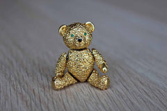Gold Tone Teddy Bear Brooch with Articulating Arms and Legs and Green Rhinestone Eyes