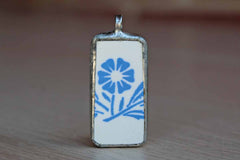 Custom-Made Charm of a Blue Cornflower Pottery Shard Encased in Silver