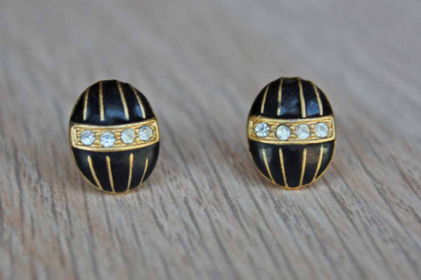 Egg-Shaped Pierced Earrings Decorated with Black Enamel and Rhinestones on a Gold Metal Base
