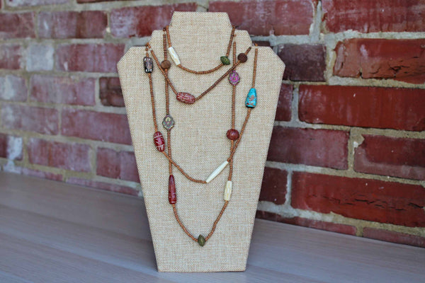 Double Strand of Carved Stone and Wood Bead Necklaces